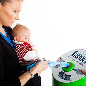 Bin in use by woman while a baby observes