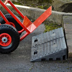 Two rubber kerb ramps used to create easy access for hand truck