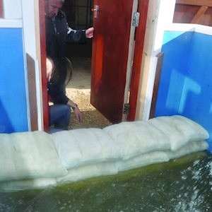 Expanding sandbags in a doorway