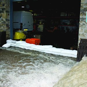 Expanding sandbags in a warehouse door