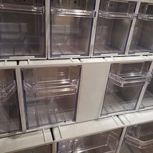 Rhino tilt storage bins with spacer
