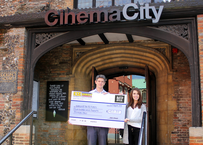 Laura Holland present the cheque to Marc Atkinson at Cinema City, Norwich