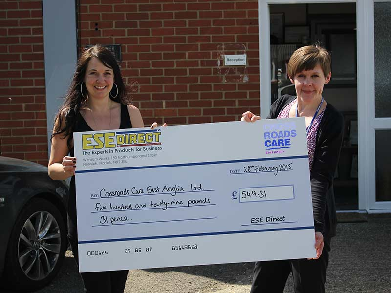Debs presents the cheque to Lorraine Sartain who accepts the cheque on behalf of Crossroads Care East Anglia