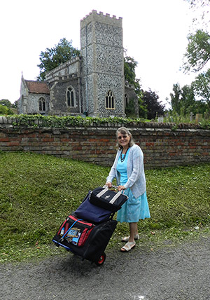 Gill with her accordion on her sack truck on her way to church