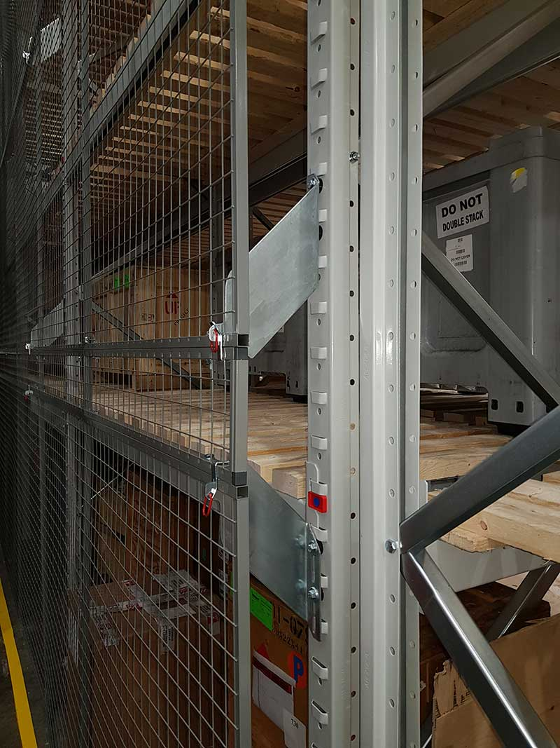 Brackets are used to attach anti-collapse mesh onto pallet racking