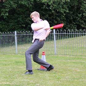 Charlie getting sporty enjoying a game of lunchtime rounders