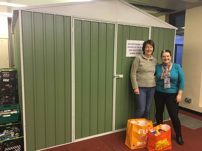 EK Community Food Bank volunteers, Lorna and Margaret McLeod with their galvanised storage shed
