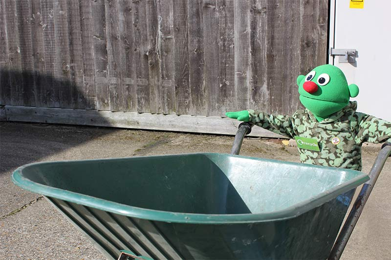 Greeny just loves to work with his green wheelbarrow