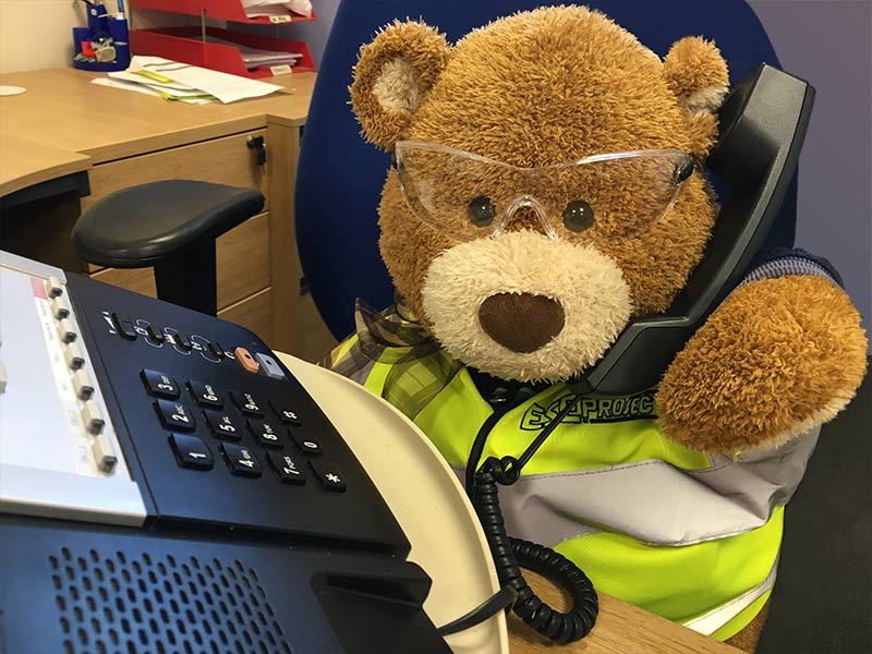 Health and Safety Bear says, Don't listen to answer phone messages on speaker