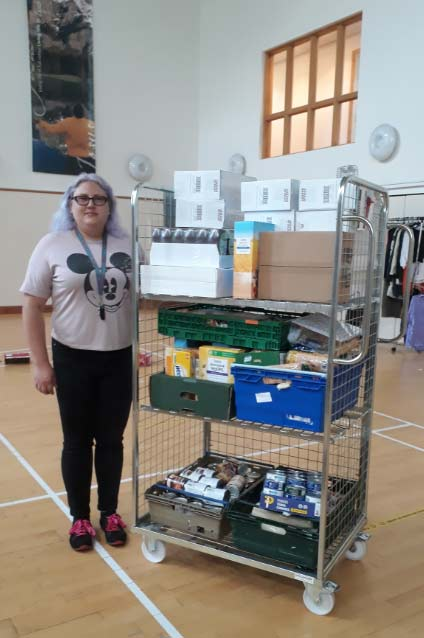Community worker Rachel Baker with the merchandise picking trolley