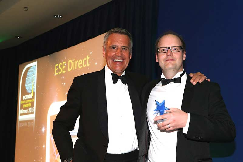 ESE Direct's Marketing Manager Martin Gilmour receives the award from Dermot Murnaghan