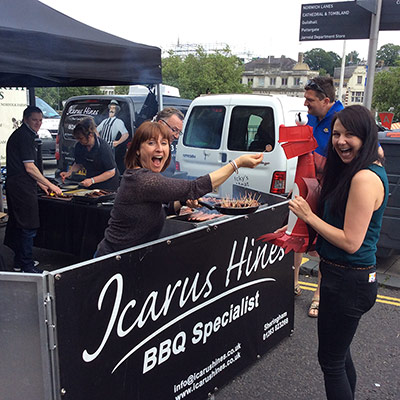George samples a sausage from Icarus Hines Butchers