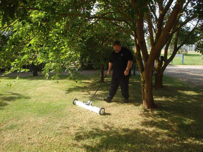 Kevin clears ferrous waste from the lawn