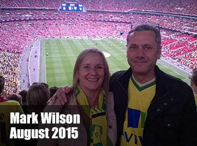 Mark Wilson and his wife at Norwich City Football Club stadium