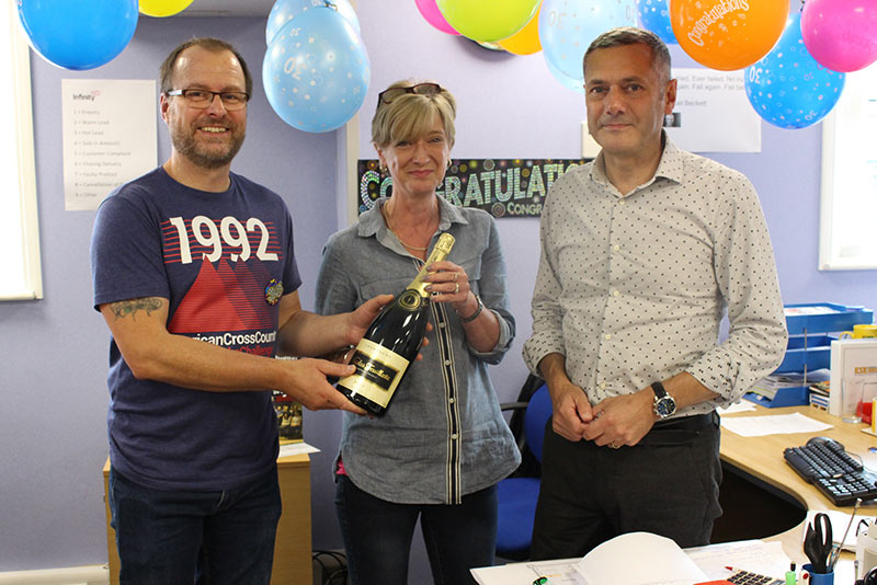 Managing Director, Jackie Wells presents Stuey with a rather large bottle of Champagne!