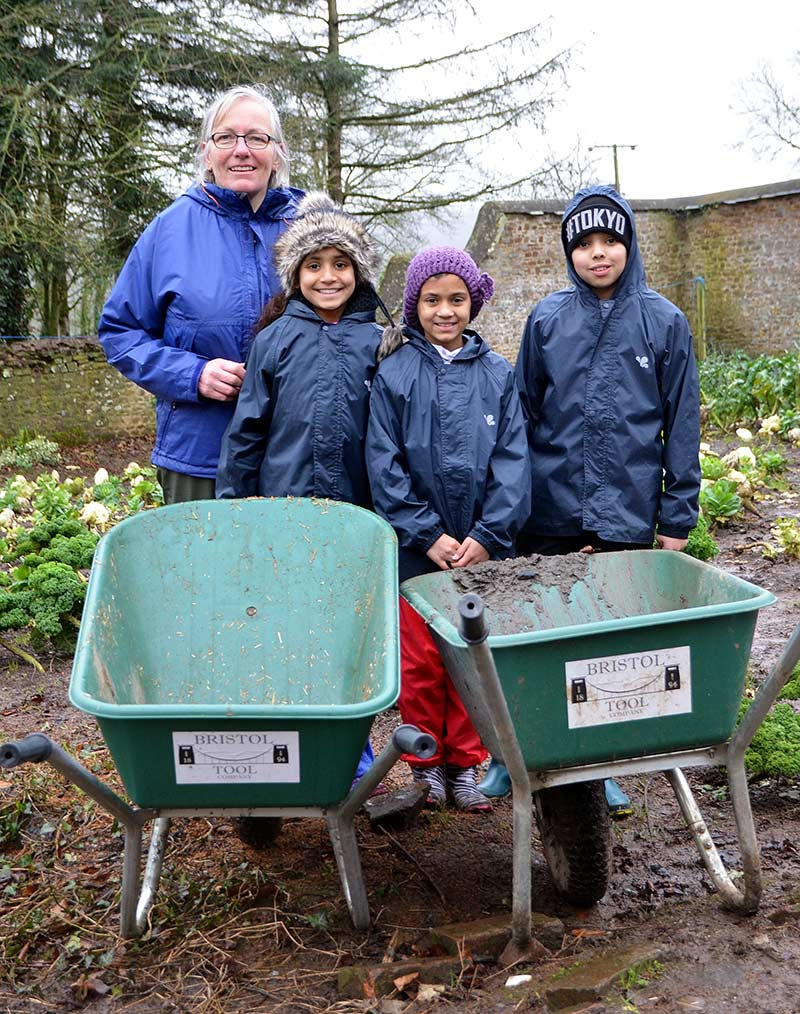 Children enjoying using the wheelbarrows donated by ESE Direct to Farms for City Children