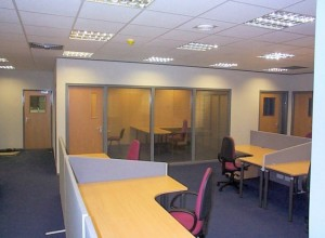 Open-plan office space with desk screens