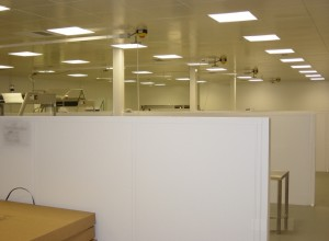 Cleanroom underneath the mezzanine floor, with low barrier steel partitioning and steel pan ceilings