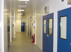 Cleanroom corridor with pressurized doors and steel pan ceiling