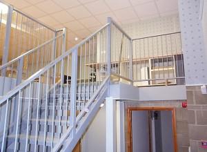 Public access staircase to mezzanine floor