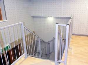 View from mezzanine of staircase , drylining and concealed bulkhead lighting