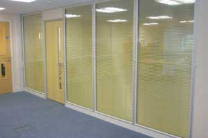 Glazed partitioning with integral venetian blinds