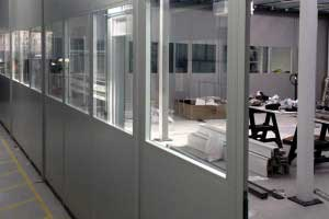 Part-glazed double skin steel partitioning