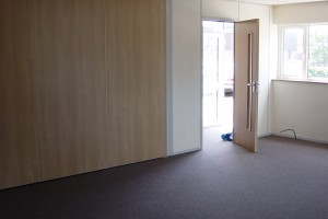 Wood_Effect_Sound_Rated_Sliding_Wall_closed_personel_door_beside