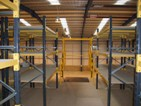 Pallet racking floor with loading gate