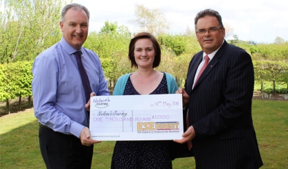 ESE MD Simon Francis presents a cheque for £1000 to Nelson's Journey