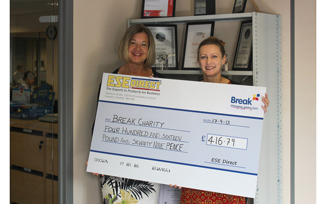 Break's Molly Housego receives the cheque for £416.79