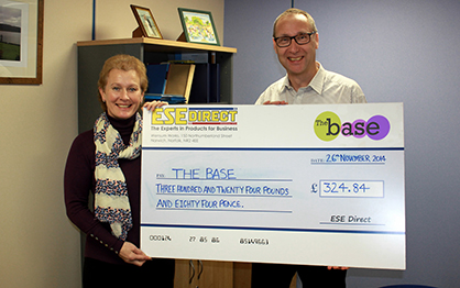 Karen Howes on behalf of The Base, accepts the cheque from Mike Wyard