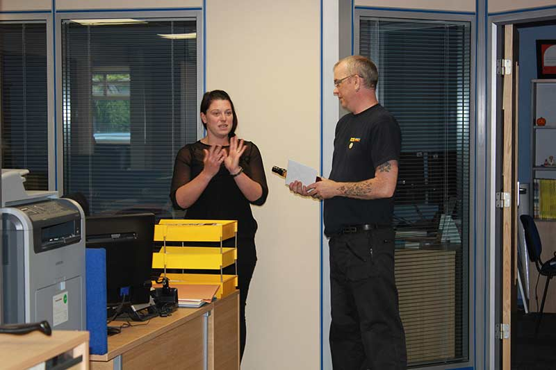 Kelly presents Martin with his leaving present