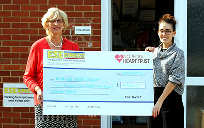 Melinda Raker from Norfolk Heart Trust receives the cheque