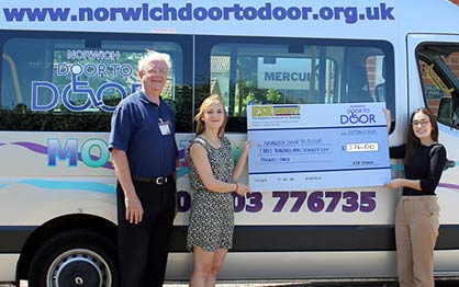Norwich Door to Door receive their cheque from Laura