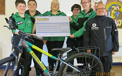 St John Ambulance Holyhead Cycle Responders with their ESE Direct cheque and responder bike