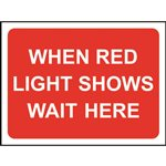 When Red Light Shows Wait Here Road Sign