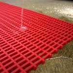 Intermediate weave PVC matting