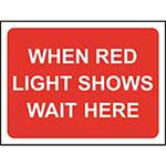 Picture of When Red Light Shows Wait Here Road Sign